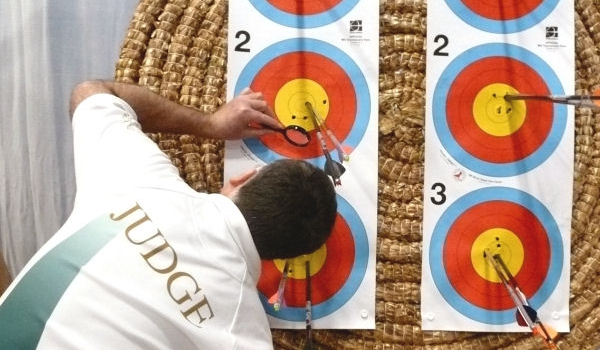 a judge checking out the value of a line cutting arrows