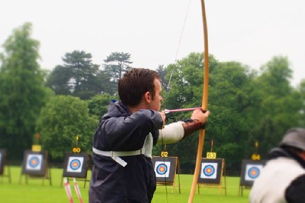 a longbow in use at an archery target competition